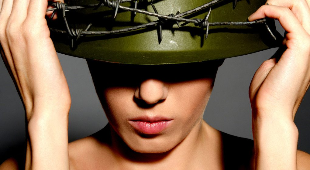 woman-with-helmet-of-military
